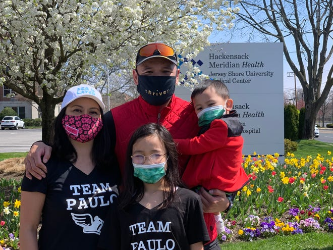 Paulo Santos (top center) with wife Christine Santos (left) and their children Ava (bottom center) and Paulo Jr. at Jersey Shore University Medical Center after Paulo's 20-mile run Saturday.