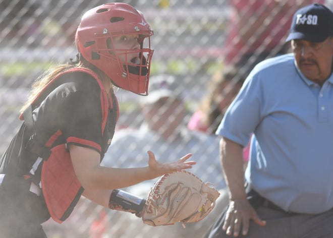 Ballinger catcher Jenna Battle reacts after a Jim Ned runner scored in a District 6-3A game Friday, April 9, 2021, in Tuscola.
