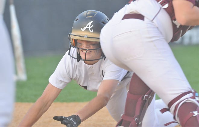 Abilene High's Leila Musquiz slides home ahead of the tag with a two-run, inside-the-park home run to give her team an 8-0 lead over Midland Lee in the third inning.