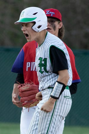Huntington's Braylon Leach celebrates hitting a double in the seventh during a game against Zane Trace on April 9, 2021. Huntington fell to Zane Trace 6-2.