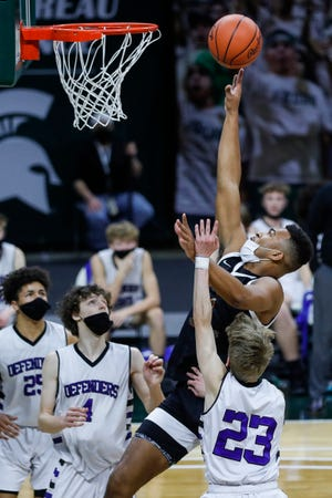 Detroit Douglass guard Pierre Brooks II (1) grabs a rebound against Wyoming Tri-unity Christian during the first half of MHSAA Division 4 boys state final at the Breslin Center in East Lansing, Saturday, April 10, 2021.