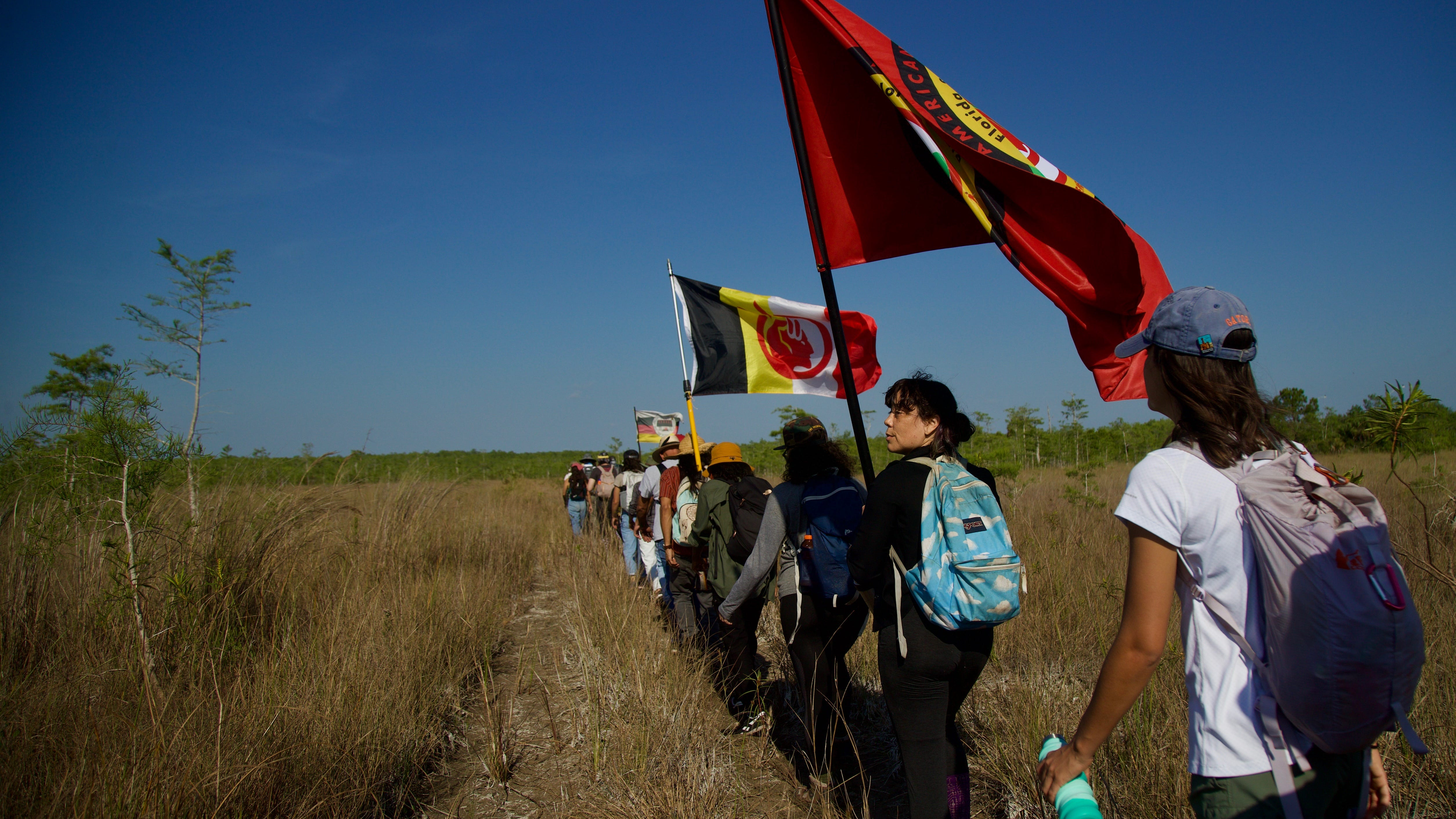 Protesters hike, speak to protest oil drilling