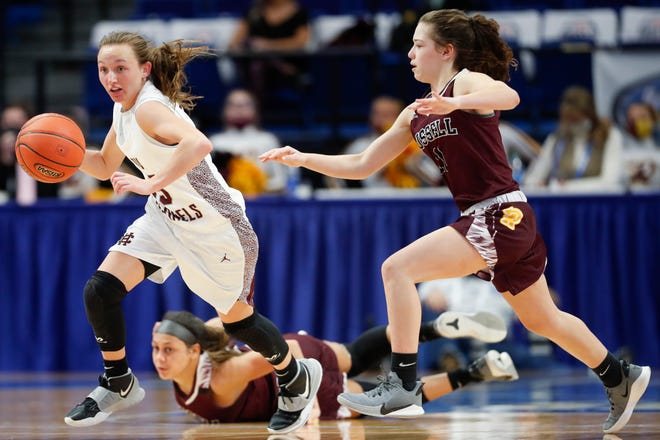 Henderson County's Sadie Wurth (15) dribbles past Russell's Shaelyn Steele (10) and Bella Quinn (11) during the KHSAA Girls' Sweet 16 quarterfinals at Rupp Arena in Lexington, Ky., Friday, April 9, 2021. Henderson County beat Russell 64-53.