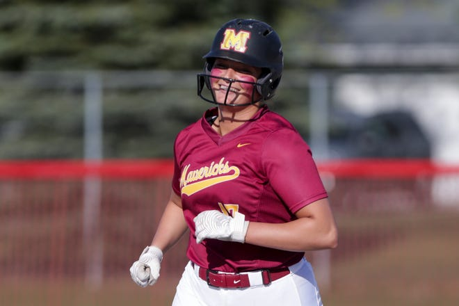 McCutcheon's Heather Johnson (17) beams as she round second on a solo home run during the fourth inning of an IHSAA softball game, Friday, April 9, 2021 in West Lafayette.