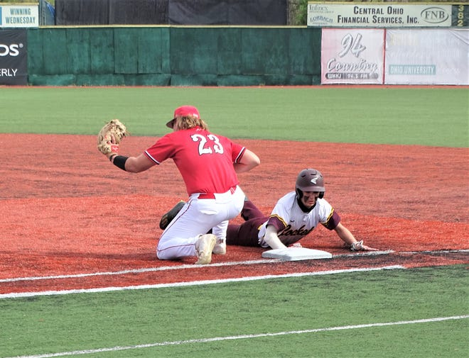 Berne Union's Sammy Amnah dives back into first base as Utica's Tanner Parsons gets set to apply a tag during their non-conference game at Chillicothe's VA Memorial Stadium on Saturday.