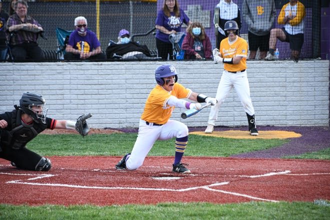 Bloom Carroll's Logan Moore attempts to lay down a bunt Friday night. The host Bullodogs prevailed over the visting Lions 4-2. -Jamie Potts/Lancaster Eagle Gazette
