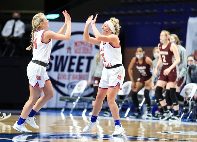 Marshall County's Presley Jezik and Layne Pea celebrate as they face Sacred Heart for the championship game at the Sweet Sixteen tournament Saturday at Rupp Arena. April 10, 2021