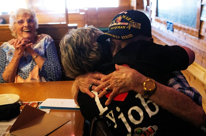 """Oris """"Duke"""" Farabee, 94 of Newark, hugs his daughter Darlene Turner, a former Newark resident who now lives in Georgia, who dressed up as a Texas Roadhouse Server Trainee as she surprised him for his 94th Birthday at Texas Roadhouse in Newark, Ohio on April 9, 2021. Turner was not able to visit him for his birthday in February this year due to COVID-19 concerns. Turner flew to Ohio with her daughter Natasha Ryan, Oris' granddaughter, and Natasha's four year-old daughter, Gabrielle, for the surprise visit. There were four generations surrounding the table during Oris' surprise visit."""