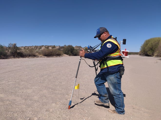 Las Cruces Utilities Corrosion Technician Stephan Klingelmeier walks the gas line that runs under the Rio Grande River's dry bed. He's checking the large transmission lines that help distribute natural gas throughout Las Cruces.