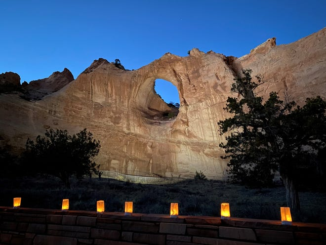 The Window Rock formation is illuminated on March 17 in tribute to members of the Navajo Nation who died of COVID-19.