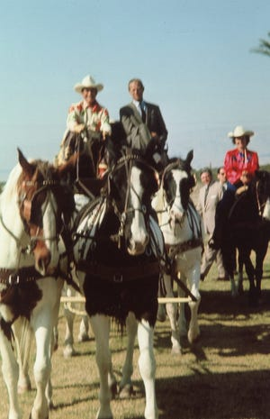 Montie Montana and His Royal Highness Prince Philip ride western-style to polo match at Eldorado 1966.
