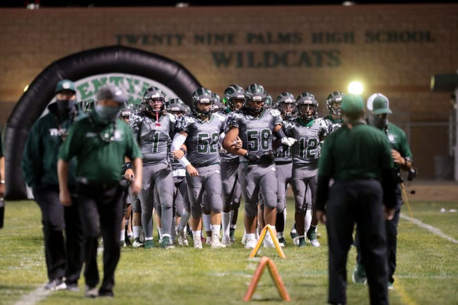 Twentynine Palms returns to the field after halftime during a football game against Yucca Valley on Friday, April 9, 2021, in Twentynine Palms, Calif.