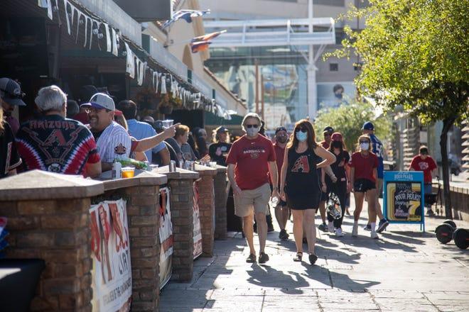 Fans walking toward Chase Field before the game, April 9, 2021, Phoenix, AZ