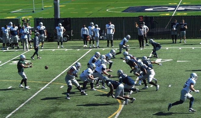 The Nevada football team runs through a play earlier this month at Wolf Pack Park.