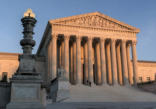 FILE - This November 6, 2020 file photo shows the Supreme Court at sunset in Washington. The Supreme Court tells California that it cannot enforce coronavirus-related restrictions that limit religious worship at home, including Bible studies and prayer meetings. The court's ruling on late Friday April 9, 2021 is the most recent in a series of cases where the Supreme Court has prevented officials from enforcing some coronavirus-related restrictions on religious gatherings.