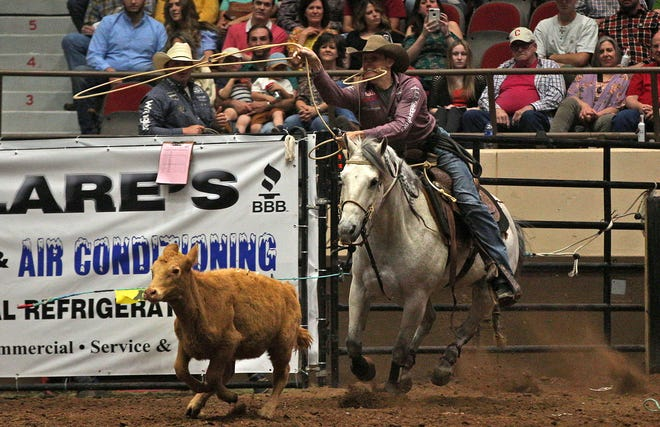 Tuf Cooper competes in the tie down roping event during the first night of competition at the San Angelo Rodeo on Friday, April 9, 2021.