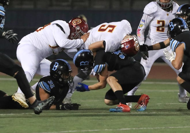 Oxnard High's Jadon Franco is tackled by Buena's Jackson Geier during a game on April 9. Franco made the Offense First Team and Geier made the Defense First Team for the Pacific View League.