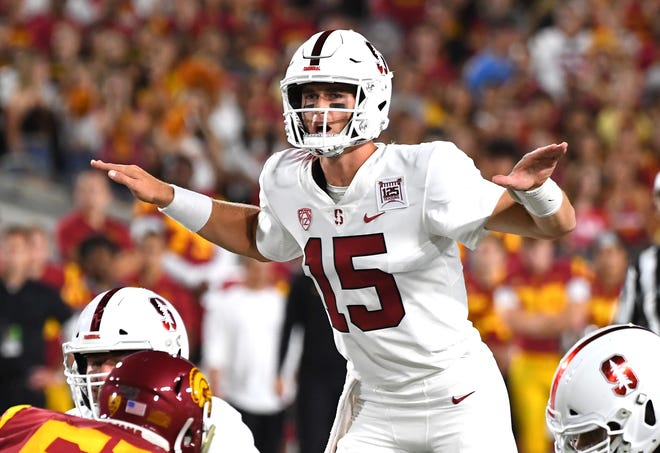 Quarterback Davis Mills of the Stanford Cardinal calls a play in the first quarter of the game against the USC Trojans at the Los Angeles Memorial Coliseum on September 7, 2019 in Los Angeles, California.