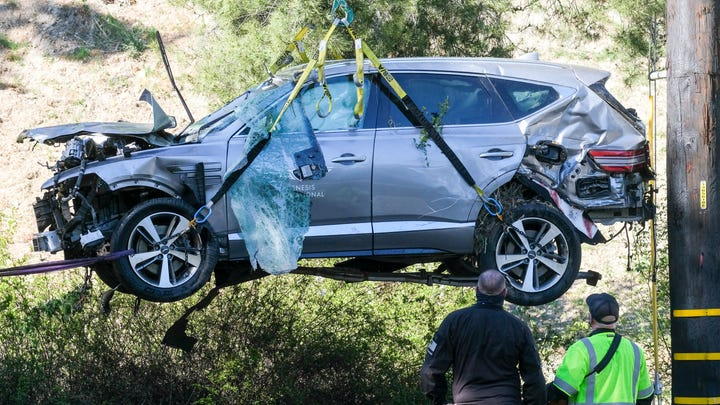A crane is used to lift Tiger Woods' vehicle following an accident involving in Rancho Palos Verdes, California