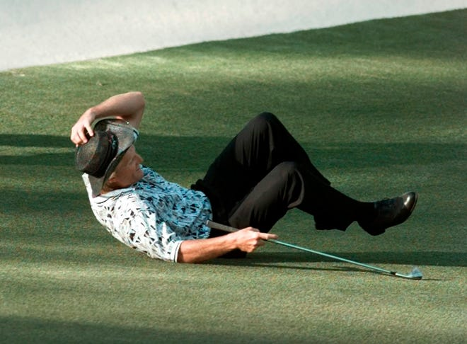 FILE - In this  Sunday, April 14, 1996 file photo, Greg Norman falls to the ground after missing his shot for an eagle on the 15th hole during final round play of the 1996 Masters at the Augusta National Golf Club in Augusta, Ga.  Norman became the only player to lose a six-shot lead in a major. (AP Photo/Dave Martin, File)
