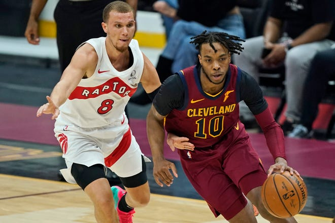 Cleveland Cavaliers' Darius Garland (10) drives against Toronto Raptors' Malachi Flynn (8) in the first half of an NBA basketball game, Saturday, April 10, 2021, in Cleveland. (AP Photo/Tony Dejak)