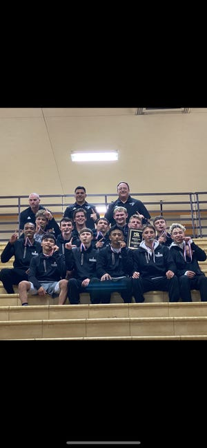 The Randall wrestling team poses together after claiming the District 3-5A team title on Saturday night at Amarillo High.