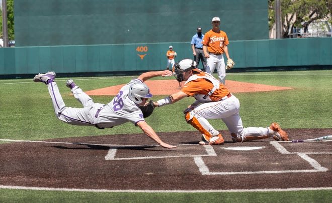 Kansas State's Zach Kokoska (28) is tagged out at the plate by Texas catcher Silas Ardoin (4) during the Longhorns' 9-2 win at UFCU Disch-Falk Field on April 11, 2021.