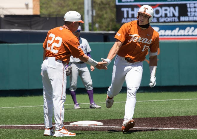 Texas head coach David Pierce congratulates Ivan Melendez as he rounds the bases after scoring his first home run of the game against Kansas State at the UFCU Disch-Falk Field on Sunday. Melendez has hit a home run in six straight games. He had two in the series finale against Kansas State.