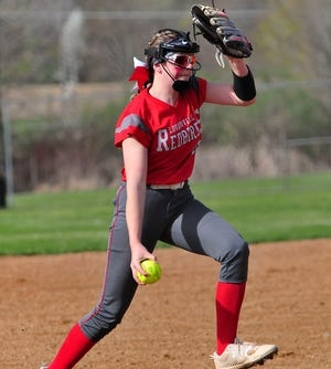 Loudonville's Karena Burgess prepares to throw a pitch against Northwestern during the Redbirds' 12-5 win Saturday at Brookside West.