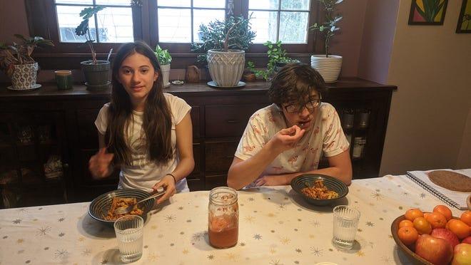 Matt Mariola's children, Clara, 13, and Luca , 16, eat pasta with the roasted pepper sauce, one of Matt's recipes.