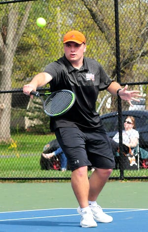 Ashland's Caedon Blough returns a shot against Shelby during a doubles match at the Ashland Invitational Saturday at Brookside Park