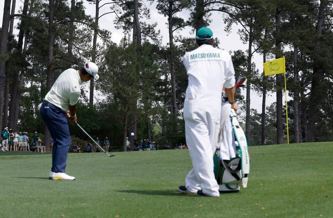 Hideki Matsuyama chips from behind the No. 3 green during Sunday's final round for the Masters. His shot to tap-in range kept his early lead intact as his foes struggled on the hole.
