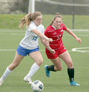 Boonville senior Olivia Imhoff battles for the ball with a Southern Boone player in the first half Friday night at the Boonville City Soccer Fields at BHS.