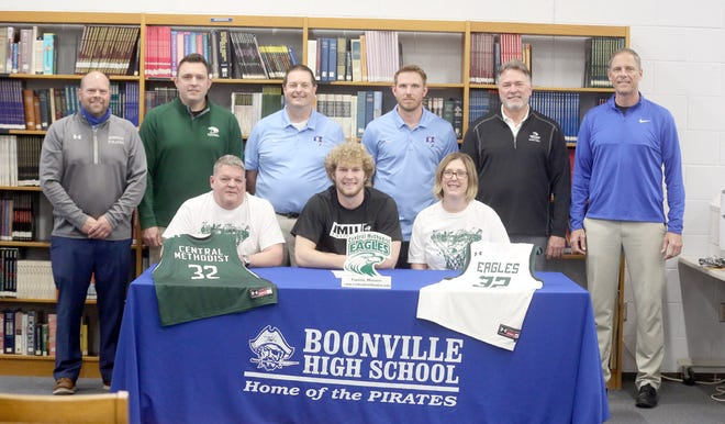 Boonville senior Charlie Bronakowski recently inked a letter of intent with basketball at Central Methodist University in Fayette. On hand during the signing last week in the media center at Boonville High School were (front row, left to right) John Bronakowski, Charlie Bronakowski and Jill Birch. (back row, left to right)Boonville Athletic Director Chris Shikles, CMU assistant coach Matt Sherman, Boonville boys basketball coach Mark Anderson, Boonville assistant coach Brock Hill, CMU men's basketball coach Jeff Sherman and Boonville Principal Tim Edwards.