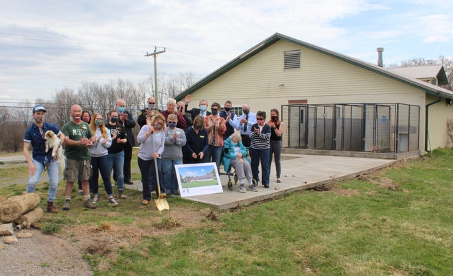 """Bearing on the golden shovel to break ground, Executive Director Bonnie Brewer said, """"We are thrilled to be beginning this next chapter for the Humane Society and our community."""""""