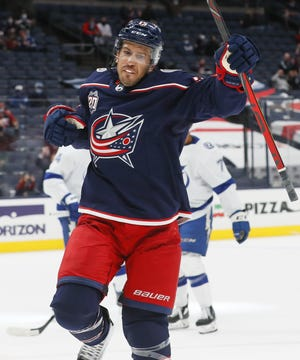 Blue Jackets defenseman Michael Del Zotto celebrates scoring a goal against Tampa Bay on Thursday.