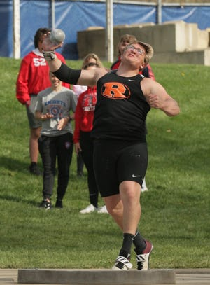 Rittman's Tyler Thompson heaves the shot put 56 feet, 9 inches to place second at the Knights Invitational Track Tournament at West Holmes on April 11, 2021. [Bob Reining /Daily Record photo]