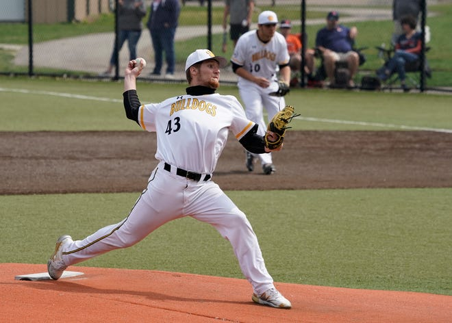 Adrian College's Trey Miller pitches during Saturday's game against Hope.