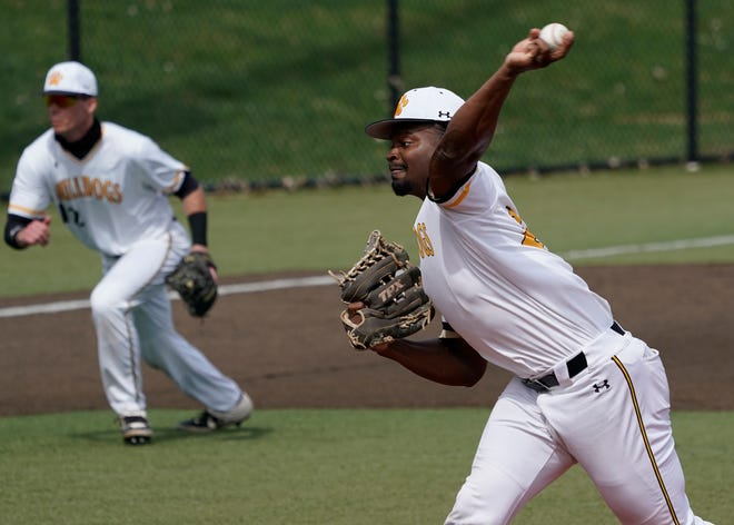 Adrian College's Mo Hanley delivers a pitch during a game Saturday against Hope.