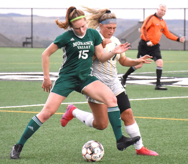 Mohawk Valley Community College freshman Reilly Rich (15) shields the ball from Herkimer College's Emma Bilinski and tries to turn it up the field during the first half Friday at Wehrum Stadium.