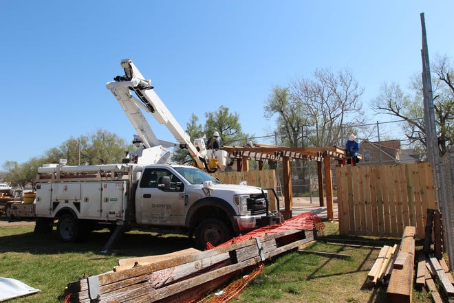 The Evergy Green Team used bucket trucks to construct an outdoor classroom on Saturday.