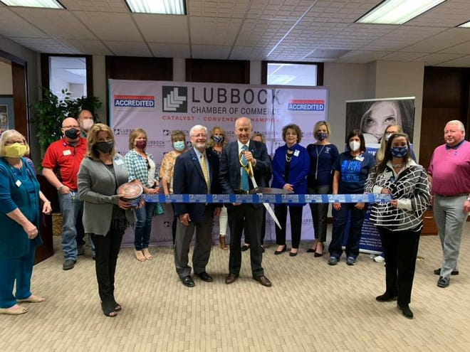 Ribbon cutting – Go Blue Lubbock Campaign Kick-off, 1500 Broadway Ste. 101, Lubbock. Holding scissors: Mayor Dan Pope. Holding ribbon: Chamber Ambassadors Renee Payne, left, and Shannon Younger. Also pictured are Lubbock Chamber President/CEO Eddie McBride, Chair, South Plains Coalition for Child Abuse Prevention; Executive Director, Parenting Cottage - Carla Olson, Chair, GO BLUE LUBBOCK; Committee Chief Program Officer, CASA of the South Plains, Lauren Westerberg;  Lubbock Chamber Ambassadors Co-Chairwoman Paulene Salamon; and other friends and Chamber Ambassadors.