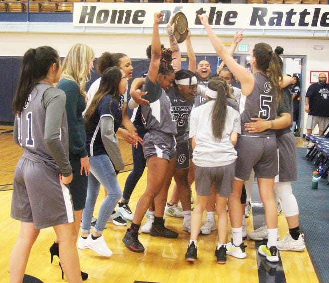 Members of the Otero Junior College women's basketball team celebrate following its 94-89 overtime win over Casper (Wyo.) College Saturday at the McDivitt Center. The win gave the Ratters the NJCAA Region IX championship and a trip to the national tournament.