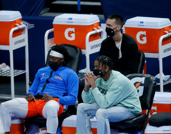 Oklahoma City's Luguentz Dort (5), Aleksej Pokusevski (17) and Shai Gilgeous-Alexander (2) sit on the bench during the fourth quarter of the NBA game between the Oklahoma City Thunder and the Philadelphia 76ers at the Chesapeake Energy in Oklahoma City, Saturday, April 10, 2021.