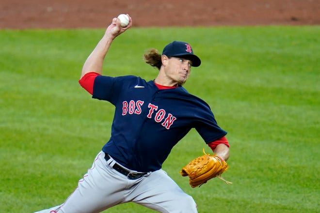 Boston Red Sox starting pitcher Garrett Richards throws a pitch to the Baltimore Orioles during the first inning of a baseball game, Saturday, April 10, 2021, in Baltimore. (AP Photo/Julio Cortez) ORG XMIT: BAB107