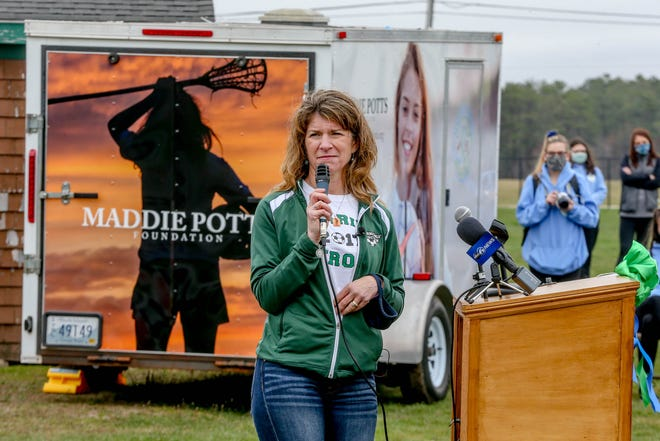 Stephanie Potts, Maddie Potts' mother, speaks at Sunday's ceremony. The Mattie Potts Foundation worked to raise $600,000 for a new field house at Chariho High School.