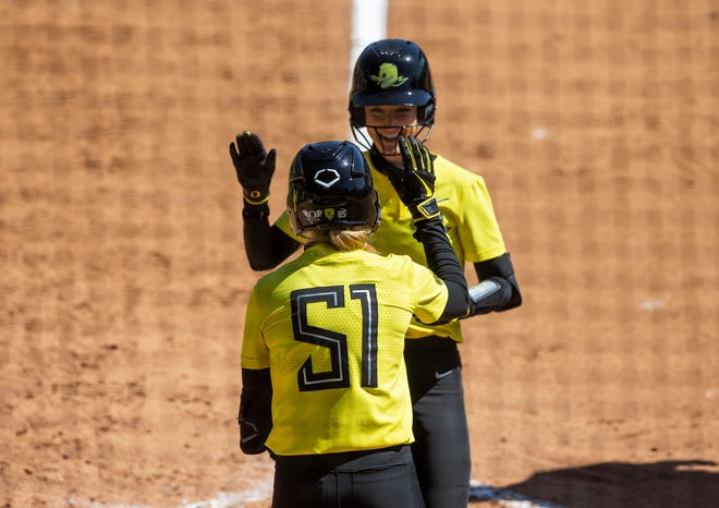 Allee Bunker (51) and Haley Cruse celebrate Cruse's home run against UCLA last Sunday at Jane Sanders Stadium. Bunker hit three home runs in the four-game series against UCLA.