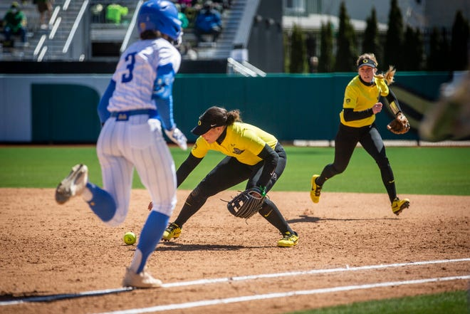 Oregon's Mya Felder drops the ball at first base, letting UCLA Briana Perez slip in and gain the upper hand in the top of the sixth inning. Oregon softball lost to UCLA Bruins 6-2 at Jane Sanders Stadium in Eugene on Sunday, April 11, 2021.