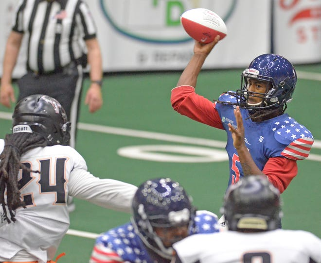 Salina Liberty quarterback Tyrie Adams (5) throws a pass against the Ohama Beef on April 10 at Tony's Pizza Events Center. The Liberty travel to Omaha on Saturday to face the Beef.