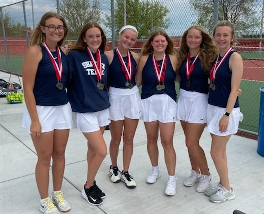 The Shawnee High School girls' tennis team poses after winning the Claremore Tournament Saturday.